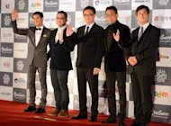 Hong Kong actors Aaron Kwok (left), Tony Leung (second right) with movie directors Longman Leung (2nd L), Sunny Luk (3rd R), and Lee yong-gwan, director of BIFF arrive at the Busan International film festival (BIFF). They were among a glittering line-up of top Asian cinema stars converging on the South Korean city for the region&#39;s premier international film festival