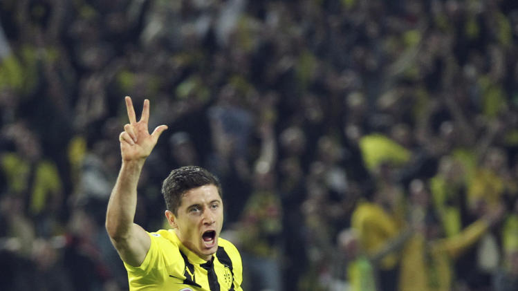 Dortmund's Robert Lewandowski celebrates after scoring his side's fourth goal during the Champions League semifinal first leg soccer match between Borussia Dortmund and Real Madrid in Dortmund, western Germany, Wednesday, April 24, 2013. (AP Photo/dpa, Friso Gensch)