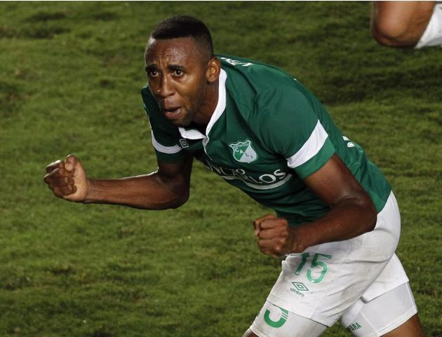 John Viafara of Colombia's Deportivo Cali celebrates scoring a goal against Argentina's Lanus during their Copa Libertadores soccer match in Cali
