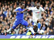 "Wigan Athletic midfielder Victor Moses (right) vies with Chelsea's Ghanaian midfielder Michael Essien during a Premier League match at Stamford Bridge in London, April 2012. The chairman of Wigan Athletic has dismissed a bid from Chelsea for Moses as derisory and accused the Champions League winners of ""taking the Mickey."""