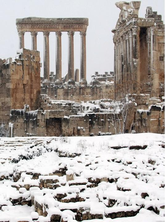 Baalbek's Bachus (R) and Jupiter (L) temples are pictured on January 9, 2013 as the Roman ruins of the historic town in eastern Lebanon's Bekaa Valley were covered with snow, following a fierce storm