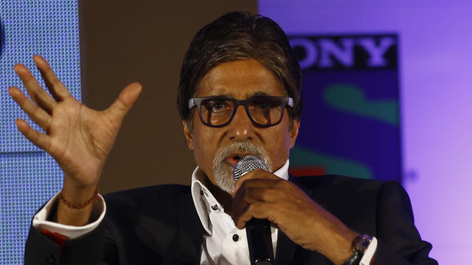 """Bollywood actor Amitabh Bachchan gestures speaks during a press conference in Mumbai, India, Wednesday, June 5, 2013. Bachchan, host of the popular quiz show """"Kaun Banega Crorepati"""", India's version of """"Who Wants To Be A Millionaire"""", is now said to produce a fiction show for the same channel. (AP Photo/Rafiq Maqbool)"""