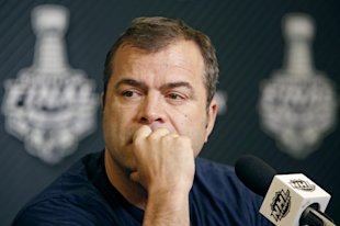 Rangers coach Alain Vigneault listens to a reporter's question during a Stanley Cup press conference in New York on Tuesday, June 10, 2014.  The Kings...