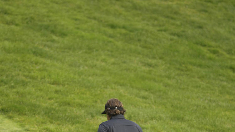 Phil Mickelson walks back to the ninth tee to hit a second ball after losing his first in a tree during the first round of the U.S. Open Championship golf tournament Thursday, June 14, 2012, at The Olympic Club in San Francisco. (AP Photo/Eric Risberg)