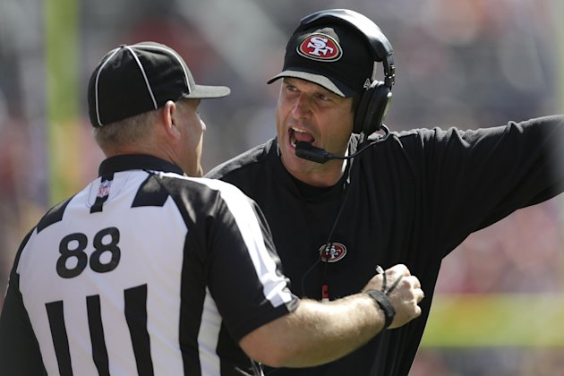 San Francisco 49ers head coach Jim Harbaugh, right, argues with an official during the second quarter of an NFL preseason football game against the Denver Broncos in Denver, Sunday, Aug. 26, 2012. (AP
