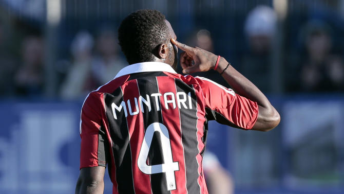 AC Milan Ghana midfielder Sulley Muntari gestures towards the crowd in Busto Arsizio, near Milan, Italy, Thursday, Jan. 3, 2012. A friendly match between AC Milan and lower division club Pro Patria was abandoned Thursday after racist chants directed at Milan's black players, the latest incident of racial abuse that continues to blight the sport. After repeated chants directed his way, Ghana midfielder Kevin-Prince Boateng picked up the ball and kicked it at a section of the crowd in the 26th minute of the first half. Boateng then took off his shirt and walked off the pitch with his Milan teammates. Urby Emanuelson, Sulley Muntari and M'Baye Niang were also targeted by the chants. (AP Photo/Emilio Andreoli)