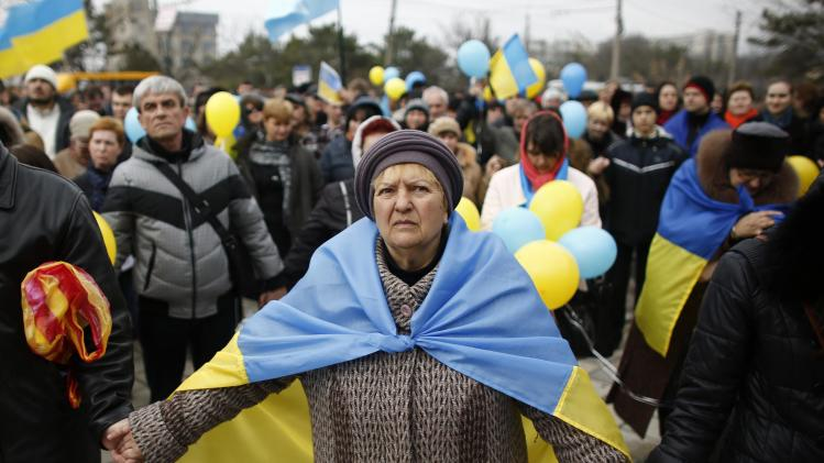 Pro-Ukrainian supporters join hands as they take part in a rally in Simferopol