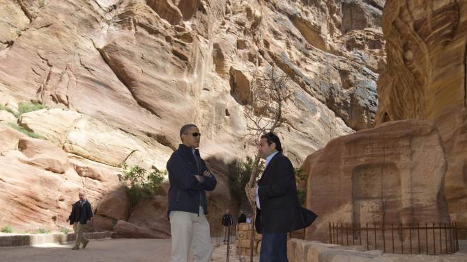 U.S. President Barack Obama pauses with Dr. Suleiman A.D. Al Farajat, right, a tourism professor with the University of Jordan, at the Ancient Shrine in the Siq during a visit to the ancient city of Petra, in south Jordan, Saturday, March 23, 2013. (AP Photo/Carolyn Kaster)