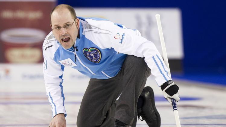 Team Quebec skip Jean-Michel Menard guides his rock in the 9th end against team Alberta during their draw during the 2014 Tim Hortons Brier curling championships in Kamloops