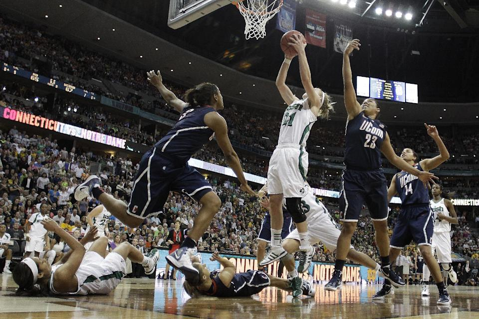Notre Dame guard Natalie Novosel (21) shoots against Connecticut forward Kaleena Mosqueda-Lewis (23) during overtime of an NCAA women's Final Four semifinal college basketball game, in Denver, Sunday, April 1, 2012. Notre Dame won 83-75. (AP Photo/Eric Gay)