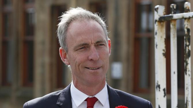 Scottish Labour Party leader Jim Murphy leaves after casting his vote in Glasgow