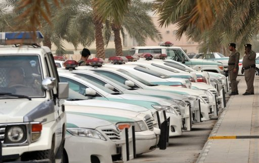 Saudi police cars are parked and policemen stand guard in front of a mosque in central Riyadh on March 11, 2011. Saudi Arabia&#39;s police force said Saturday it is investigating a series of attacks against members of the force in the Shiite-majority district of Qatif