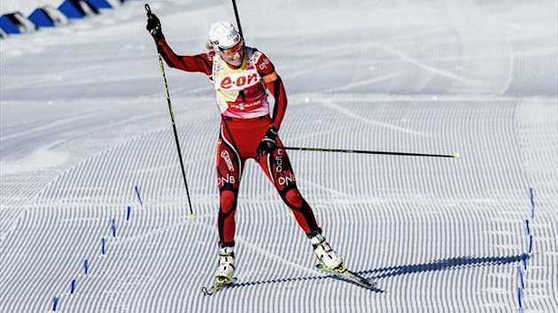 Norway's winner Tora Berger celebrates after competing in the women's 12,5 km mass start race Biathlon World Cup in Oslo (AFP)