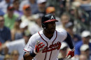 Atlanta Braves' Jason Heyward hits a double in the sixth inning of a baseball game against the Kansas City Royals, Wednesday, April 17, 2013, in Atlanta. The Royals won 1-0. (AP Photo/David Goldman)
