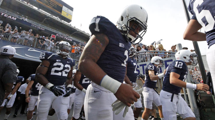 Penn State's Bill Belton (1) runs onto the field for warm ups before an NCAA college football game against Ohio at Beaver Stadium in State College, Pa., Saturday, Sept. 1, 2012. (AP Photo/Gene J. Puskar)