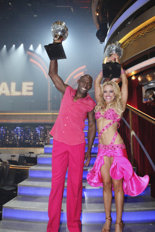 "In a photo provided by ABC Donald Driver and Peta Murgatroyd hold up their trophies after they were selected ""Dancing with the Stars"" champions Tuesday May 21, 2012. They won the ABC dance show Tuesday after wowing audiences and judges with his kickin' country-themed freestyle routine. (AP Photo/ABC/ADAM TAYLOR)"