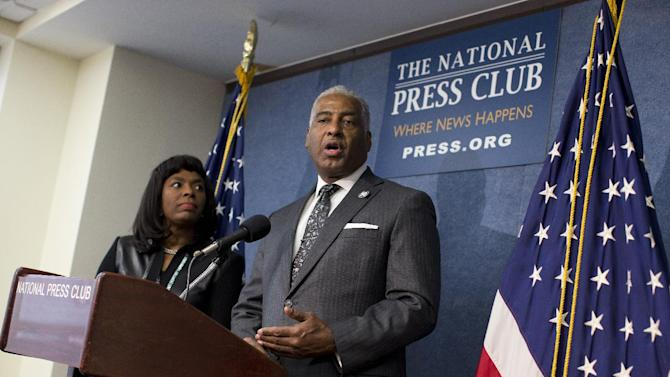 Birmingham, Ala. Mayor William Bell, right, accompanied by Rep. Terri Sewell, D-Ala., speaks during a news conference at the National Press Club in Washington, Tuesday, Jan. 22, 2013, to announce plans to ask for the Congressional Gold Medal for the four little girls killed in the 1963 bombing at the 16th Street Church in Birmingham, Ala. (AP Photo/ Evan Vucci)