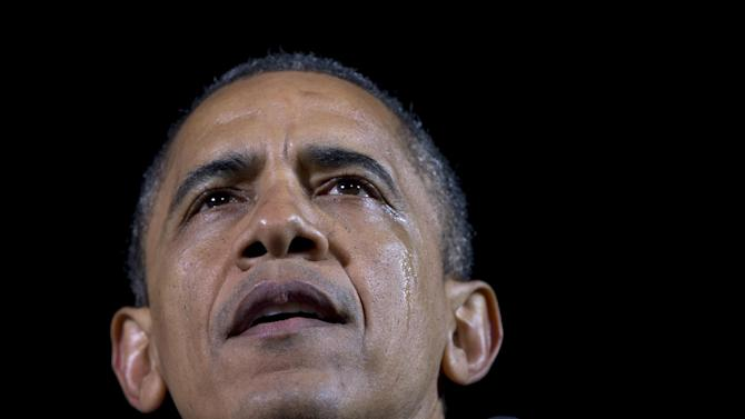 President Barack Obama speaks, as a tear streams down his face, at his final campaign stop on the evening before the 2012 presidential election, Monday, Nov. 5, 2012, in Des Moines, Iowa. (AP Photo/Carolyn Kaster)