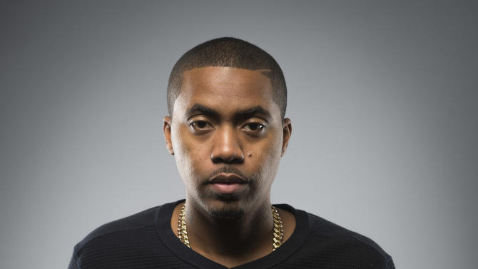 "This Dec. 20, 2012 photo shows American rapper and actor Nas, born Nasir Jones, posing in New York. Nas is nominated for four Grammys, including best rap album for ""Life Is Good,"" best rap song and best rap performance for ""Daughters,"" and best rap/sung collaboration for ""Cherry Wine,"" which features the late Amy Winehouse. The Grammy Awards will air live Feb. 10. (Photo by Scott Gries/Invision/AP Images)"