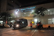 A police morgue vehicle is parked in front of the Mount Elizabeth hospital in Singapore on December 29, 2012, to retrieve the dead body of the Indian gang-rape victim. The 23-year-old woman died Saturday in Singapore after suffering severe organ failure, the hospital treating her said, in a case that sparked widespread street protests over violence against women