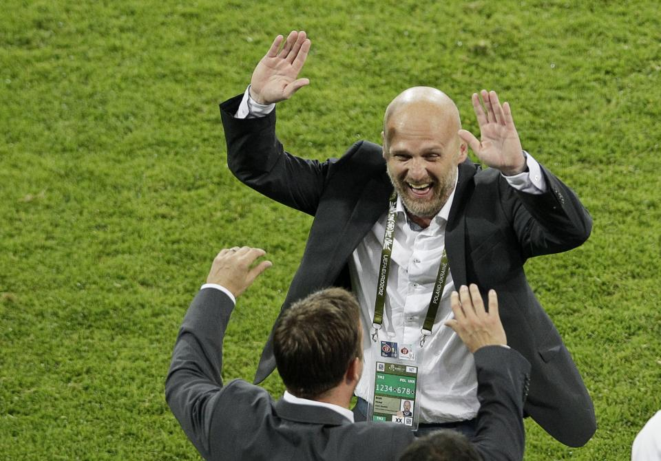 Czech head coach Michal Bilek celebrates after the Euro 2012 soccer championship Group A match between Czech Republic and Poland in Wroclaw, Poland, Saturday, June 16, 2012. (AP Photo/Antonio Calanni)