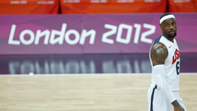 United States' Lebron James looks back at the bench during the first half of a preliminary men's basketball game against France at the 2012 Summer Olympics, Sunday, July 29, 2012, in London. The U.S. men beat France 98-71. (AP Photo/Jae C. Hong)