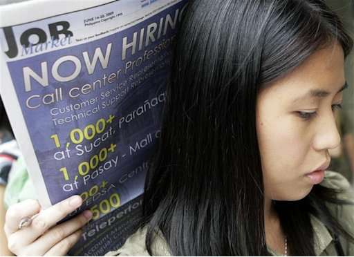 A job seeker queues to submit application forms during a job fair at a mall in Manila