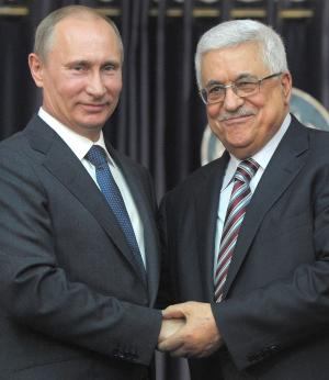 "Russian President Vladimir Putin, left, and Palestinian President Mahmoud Abbas, right, shake hands during a media briefing following their meeting, in the West Bank town of Bethlehem, Tuesday, June 26, 2012. Visiting Russian President Vladimir Putin praised his Palestinian counterpart Tuesday for what he said was a ""responsible"" position in negotiations with Israel, frozen for nearly four years, and said Russia has no problem recognizing a Palestinian state. (AP Photo/RIA Novosti, Alexei Druzhinin, Presidential Press Service)"