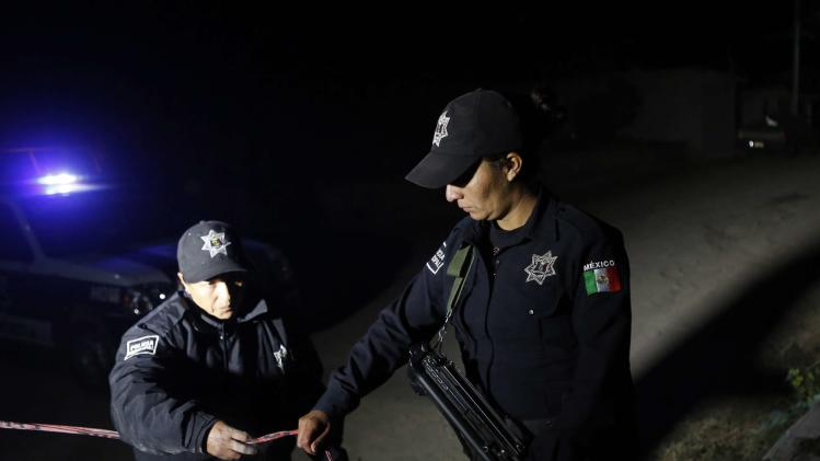 Federal police secure the area after dangerous radioactive medical material were found on a truck in Hueypoxtla