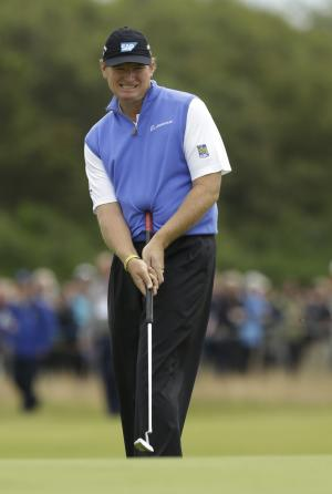 """FILE - This July 19, 2012 file photo shows Ernie Els of South Africa reacting to a putt on the 11th green at Royal Lytham & St Annes golf club during the first round of the British Open Golf Championship in Lytham St Annes, England. Els is ready to """"play ball"""" even without a long putter. The four-time major champion, who won last year's British Open with a belly putter, said Wednesday, May 22, 2013 that the PGA Tour should accept the decision by golf's ruling bodies to ban anchoring and long-handled putters in 2016. (AP Photo/Jon Super, File)"""