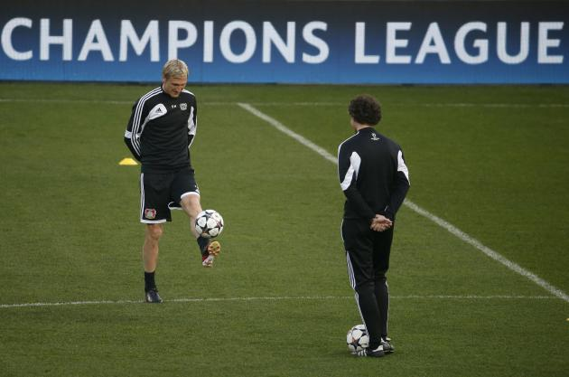 Bayer Leverkusen's coach Sami Hyypia controls the ball as he leads a training session at the Parc des Princes stadium in Paris