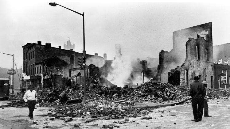 FILE - Smouldering ruins remain where a building stood on 7th Street, N.W. in Washington, D.C., April 6, 1968.  Numerous fires accompanied the second night of turmoil in the nation's capital following the assassination of Dr. Martin Luther King, Jr., in Memphis, Tenn., April 4.  The civil rights leader was standing on the balcony of the Lorraine Motel when he was killed by a rifle bullet on April 4, 1968. James Earl Ray pleaded guilty to the killing and was sentenced to 99 years in prison. He died in prison in 1998.(AP Photo)