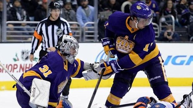 Martin Jones #32 of the Los Angeles Kings makes a save in front of Anze Kopitar #11 and Aaron Ness #55 of the New York Islanders during a 3-0 win at Staples Center on December 7