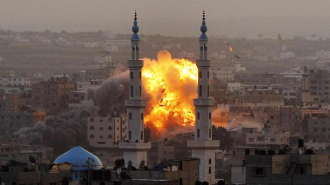 FILE - In this Nov. 17, 2012 file photo, smoke rises during an explosion from an Israeli strike in Gaza City. In a report published Feb. 12, 2013, Human Rights Watch, a U.S.-based rights group said Israel violated laws of war in a series of airstrikes during an eight-day military operation last November against the Hamas militant group in the Gaza Strip. (AP Photo/Hatem Moussa, File)