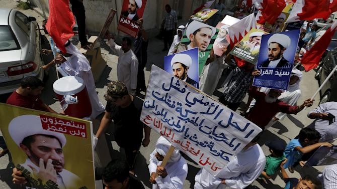 Protesters take part in a demonstration after Friday prayers in the village of Diraz