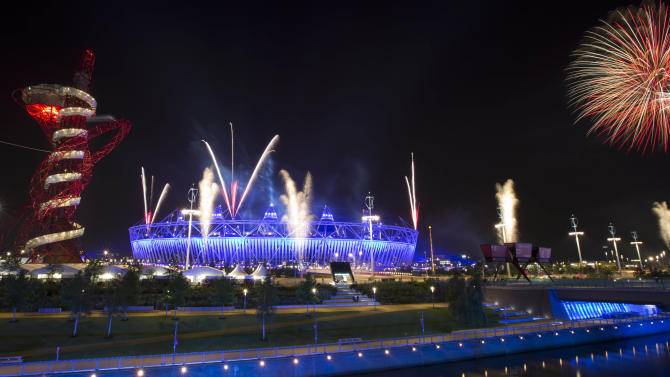 Fireworks explode over the Olympic Stadium during a rehearsal for the opening ceremony at the 2012 Summer Olympics, Wednesday, July 25, 2012, in London. The city will host the 2012 London Olympics with opening ceremonies for the games scheduled for Friday, July 27. (AP Photo/Ben Curtis)