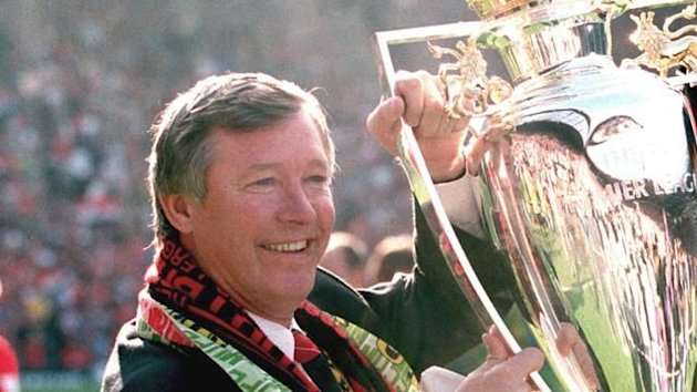Manchester United manager Alex Ferguson with the 1994 Premier League trophy