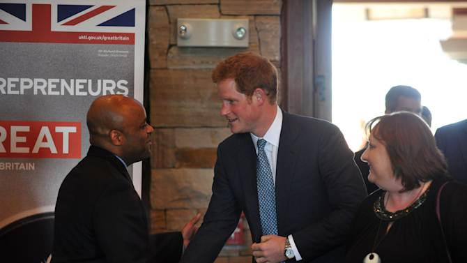 Denver Mayor Michael Hankock, left, welcomes Britain's Prince Harry at a reception at Club House of Sanctuary Golf Course in Sedalia, Colo., Friday, May 10, 2013. The visit is part of a weeklong visit to the United States that started in Washington and will also include trips to parts of New Jersey damaged by Superstorm Sandy. (AP Photo/The Denver Post, Hyoung Chang, Pool)