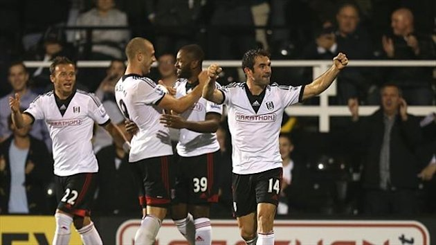 Darren Bent, second right, celebrates scoring the winner for Fulham