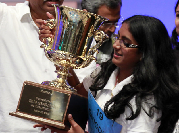 Snigdha Nandipati, 14, of San Diego, holds the trophy after winning the National Spelling Bee with the word &quot;guetapens&quot; Thursday, May 31, 2012 in Oxon Hill, Md. (AP Photo/Alex Brandon)