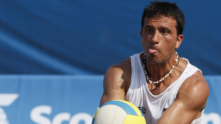 Argentina's Pablo Suarez, in action, during the men's beach volleyball bronze medal match against Mexico at the Pan American Games in Puerto Vallarta, Mexico, Saturday Oct. 22, 2011. (AP Photo/Ariana Cubillos)