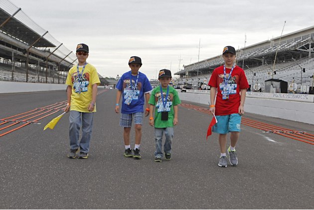 "IMAGE DISTRIBUTED FOR HOT WHEELS - From left,  Samson Poniatowski, Tucker Weisman, Alex Bartlett and Christopher Bienusa prepare for the Hot Wheels ""World's Best Driver Championship"" on the front stra"