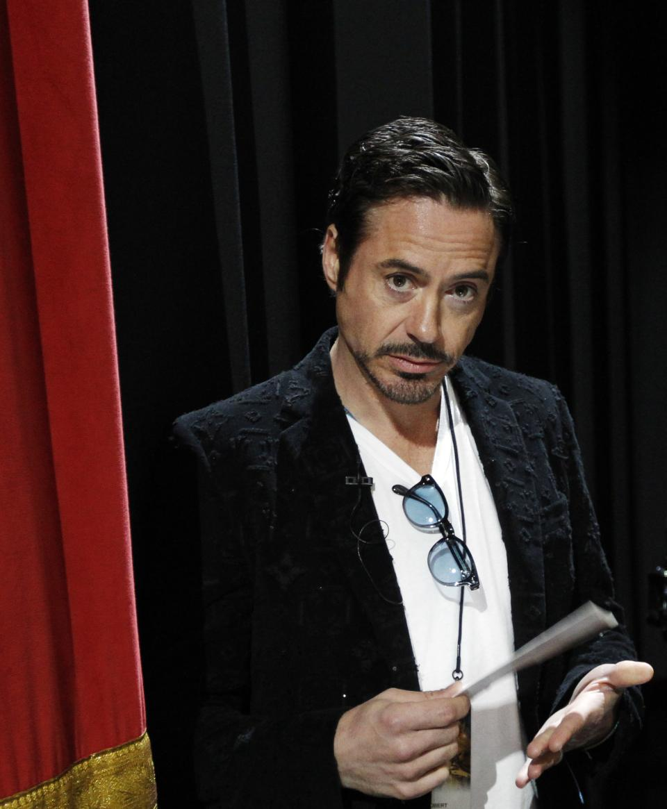 Robert Downey Jr. prepares to rehearse for Sunday's 84th Academy Awards, Saturday, Feb 25, 2012 in Los Angeles. (AP Photo/Chris Carlson)