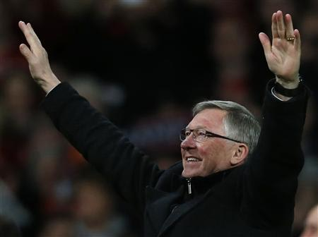 Manchester United's manager Alex Ferguson celebrates after his team clinched the English Premier League soccer title with a win against Aston Villa at Old Trafford in Manchester, northern England, April 22, 2013. REUTERS/Phil Noble