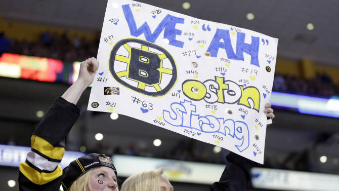 Fans hold up a sign during the second period of an NHL hockey game between the Boston Bruins and the Buffalo Sabres in Boston Wednesday, April 17, 2013. (AP Photo/Elise Amendola)