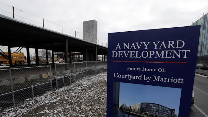 In this Wednesday, Feb. 6, 2013 photo, shown is Marriott hotel under construction at the Navy Yard in Philadelphia. The city's Navy Yard is celebrating a milestone that skeptics might not have believed 15 years ago. Nearly all naval operations are long gone from the sprawling former shipyard but 10,000 people now work there in an eclectic mix of businesses from fashion to pharmacies. That number is expected to triple in 20 years. (AP Photo/Matt Rourke)