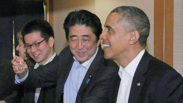U.S. President Obama talks with Japan's PM Abe during dinner at Sukiyabashi Jiro sushi restaurant in Tokyo's Ginza district