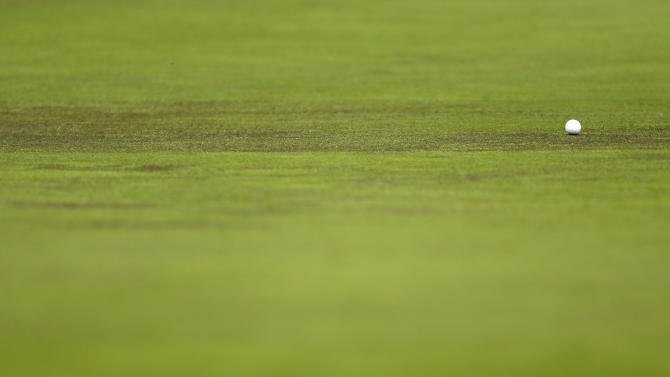A golf ball rests on a bald spot on the ninth green during the pro-am of the Wells Fargo Championship golf tournament at Quail Hollow Club in Charlotte, N.C., Wednesday, May 1, 2013. (AP Photo/Chuck Burton)