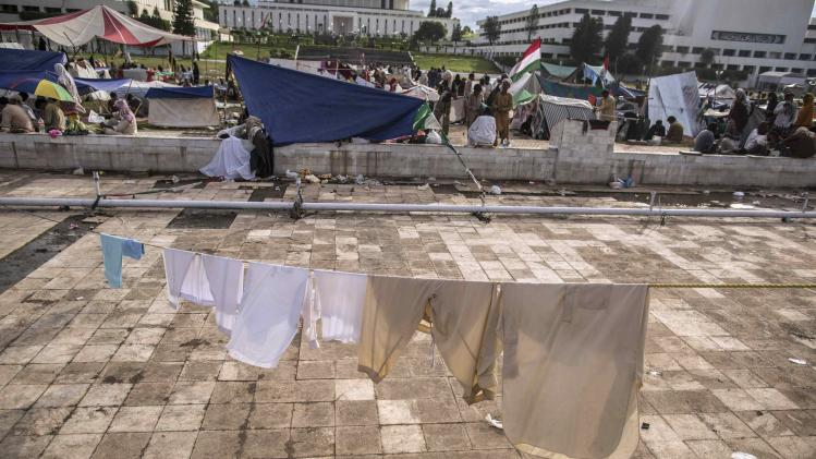 Laundry of anti-government protesters hang on a clothesline in front of the President House during the Revolution March in Islamabad