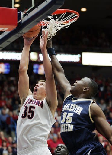 No. 12 Arizona pulls away at finish to win opener